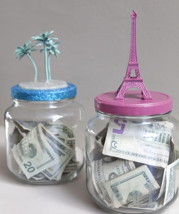 Clear jars containing money and a spraypainted landmark