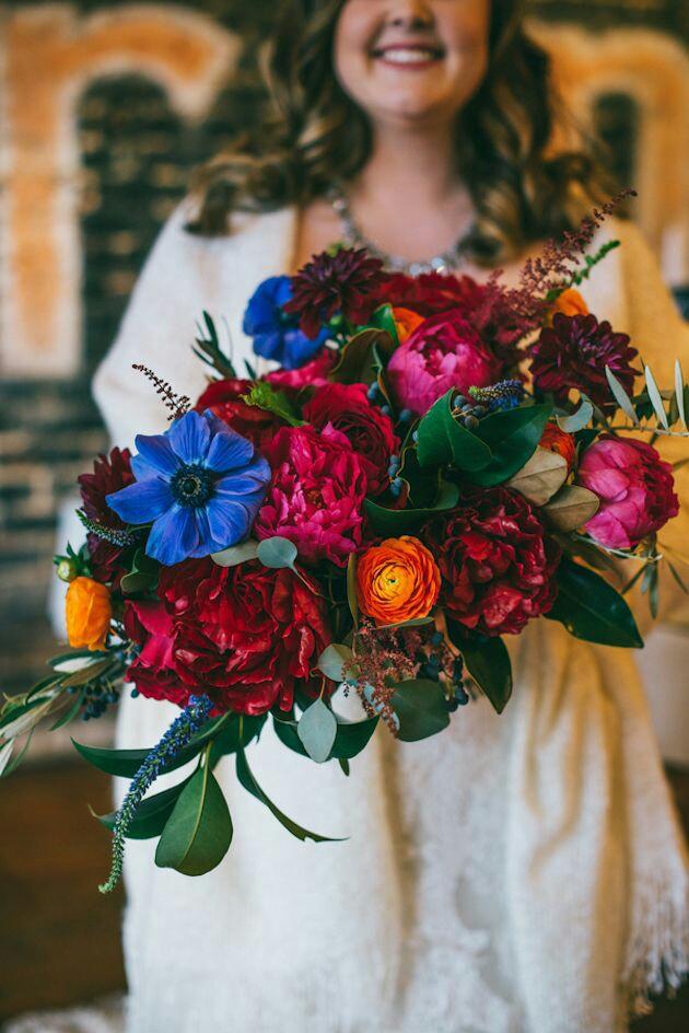 Jewel coloured brides bouquet