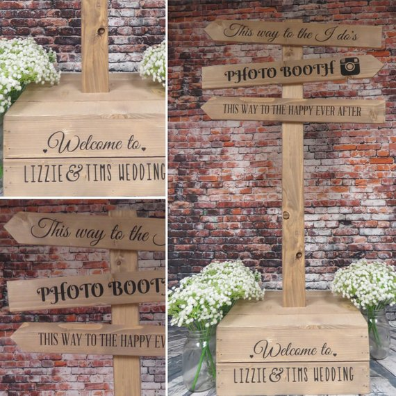 Rustic wedding signposts