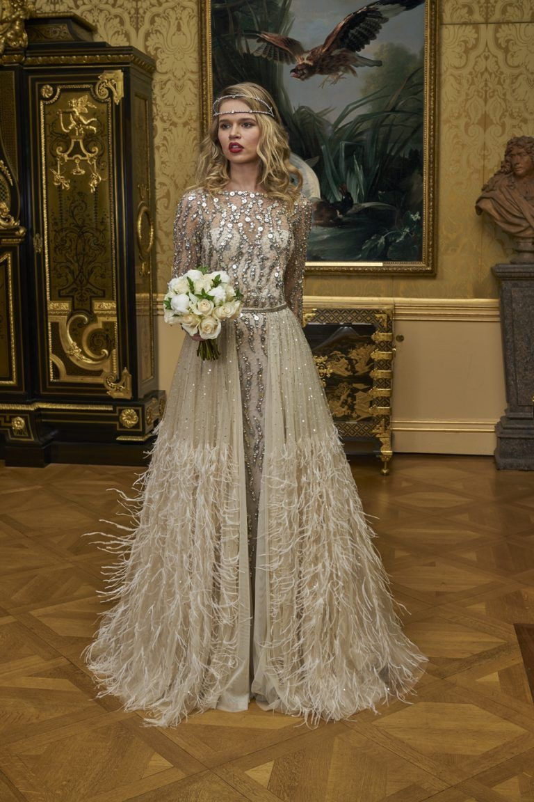 Gold sequinned long sleeved wedding dress
