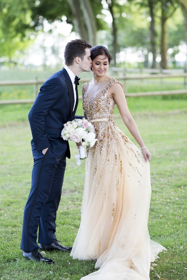 Gold wedding dress and navy suit