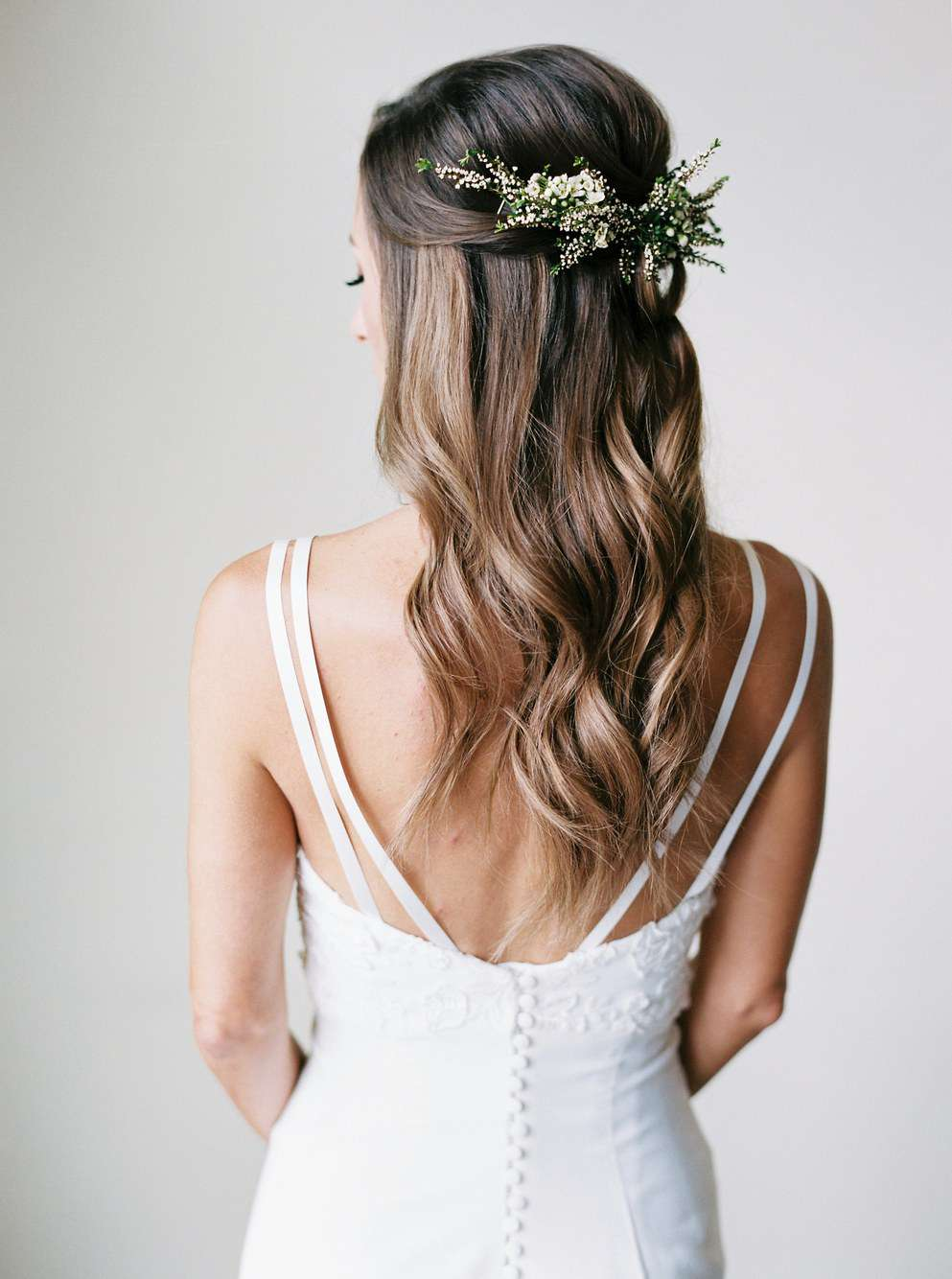 Half up half down Bridal hairstyle with flowers