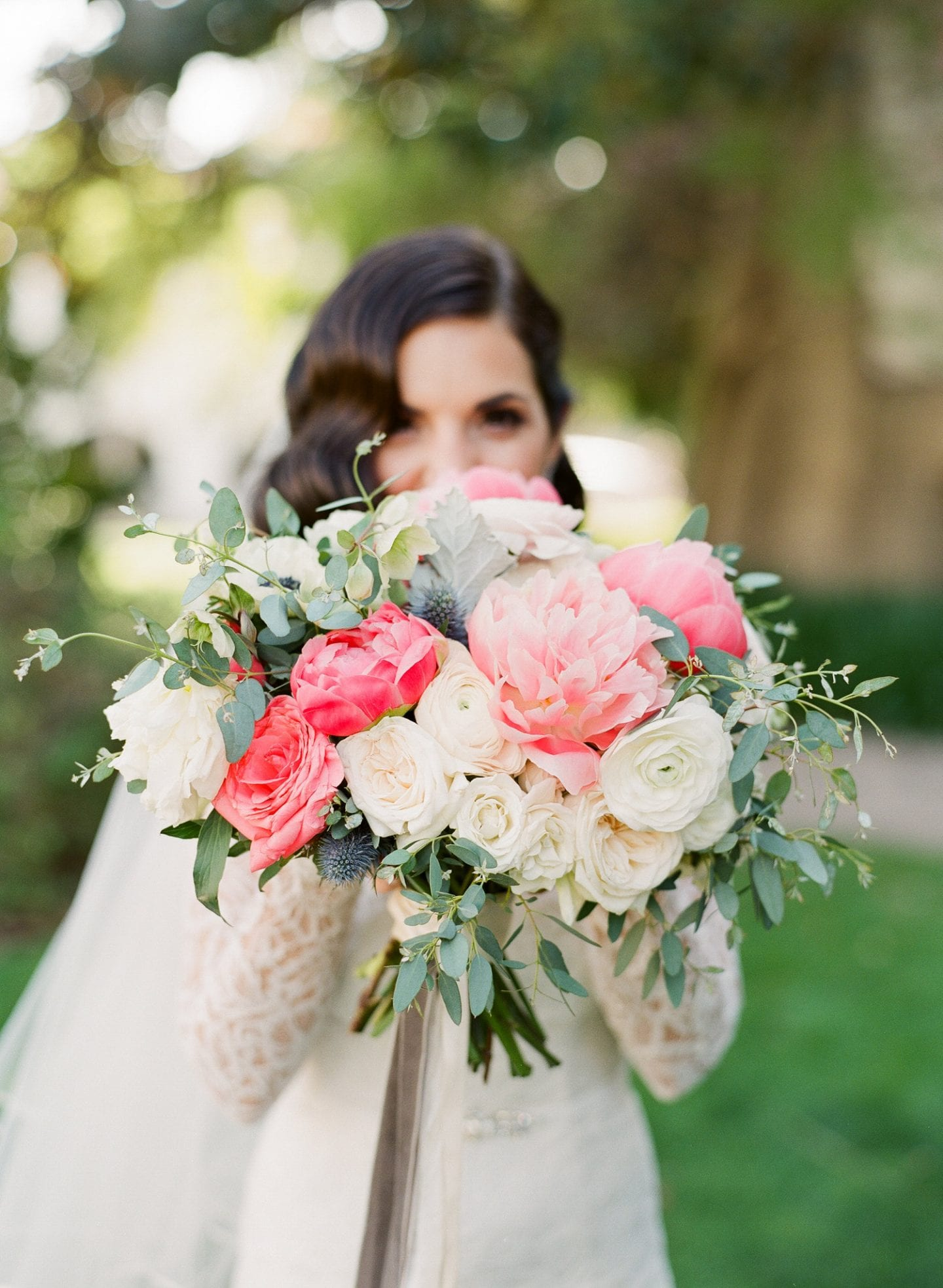 Pink and ivory brides wedding bouquet