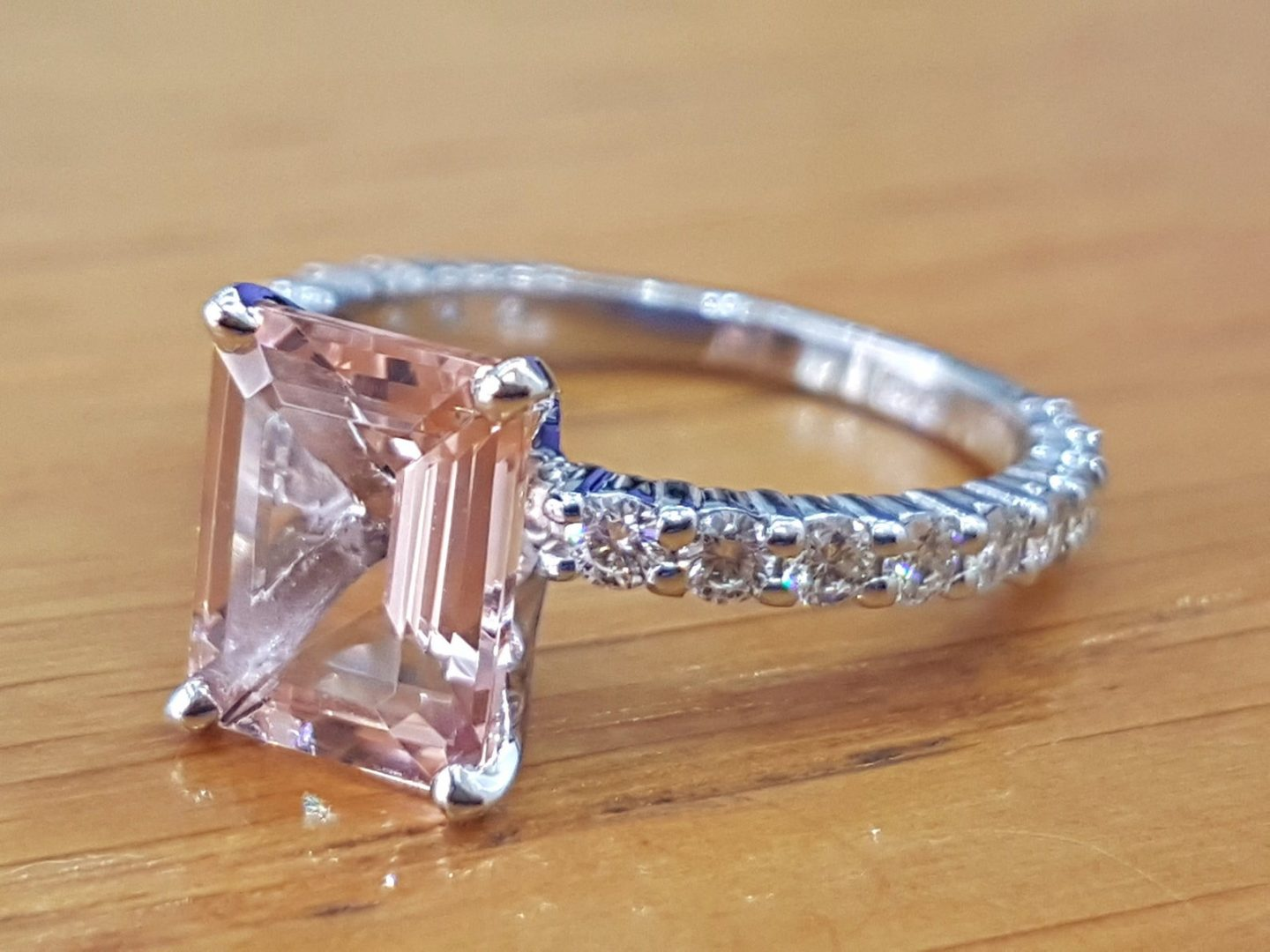 Emerald cut pink engagement ring