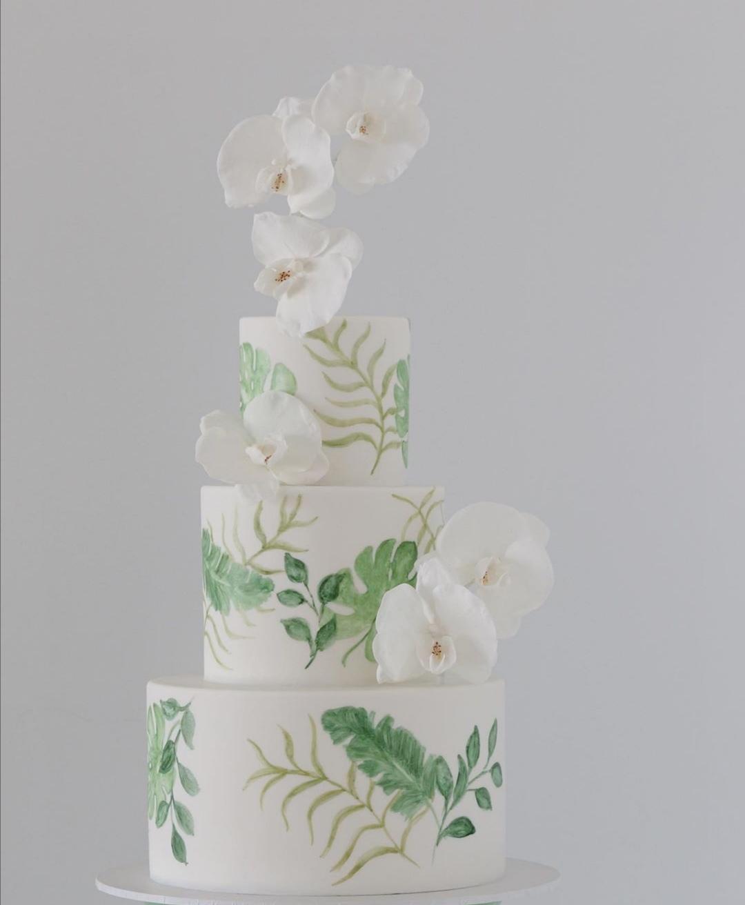 Green painted wedding cake