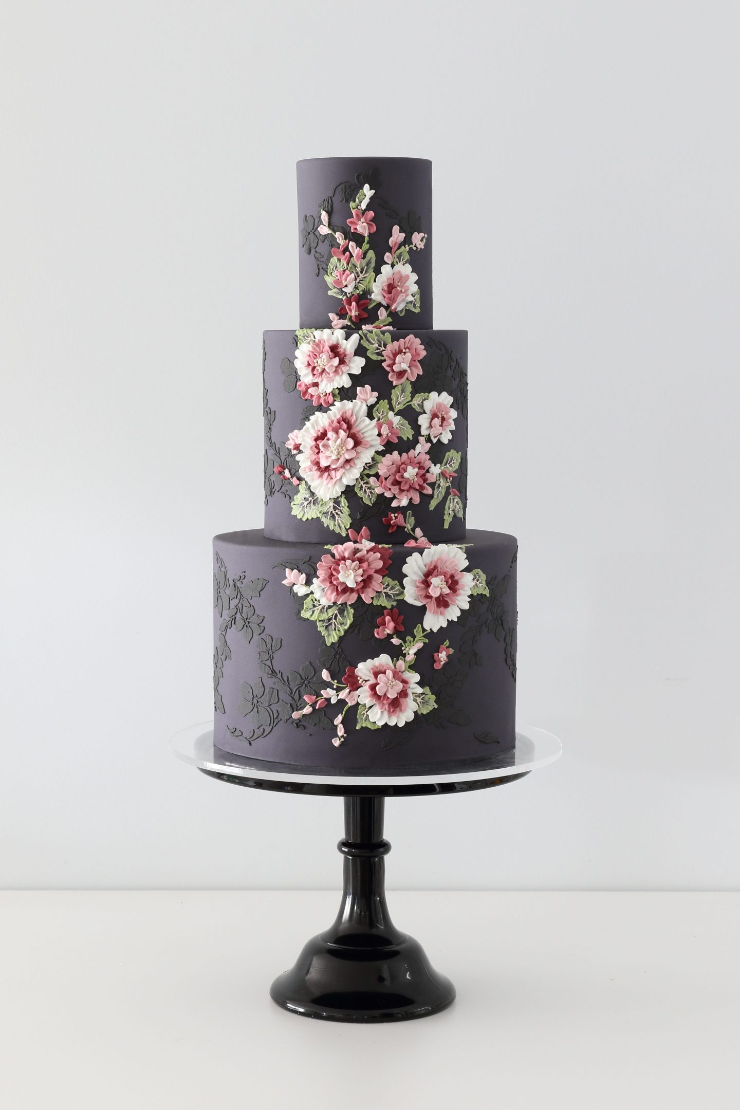 Dark and moody floral wedding cake