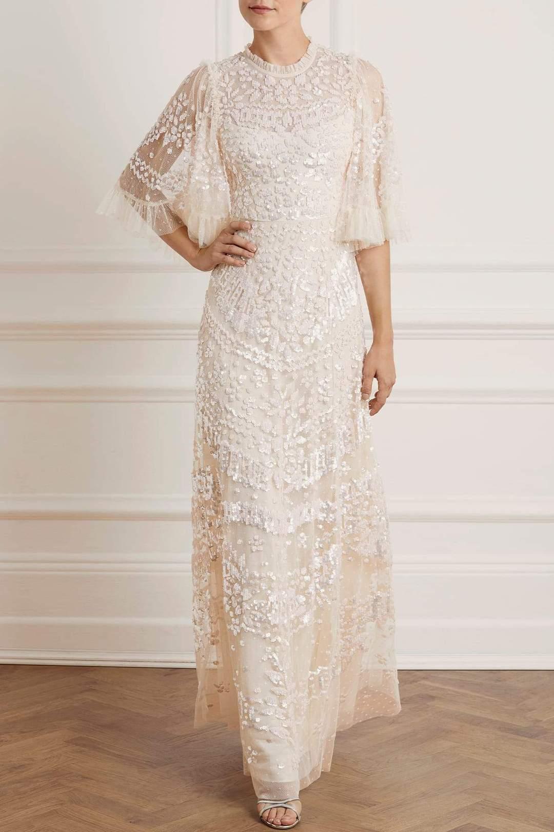 Needle and thread wedding dress.