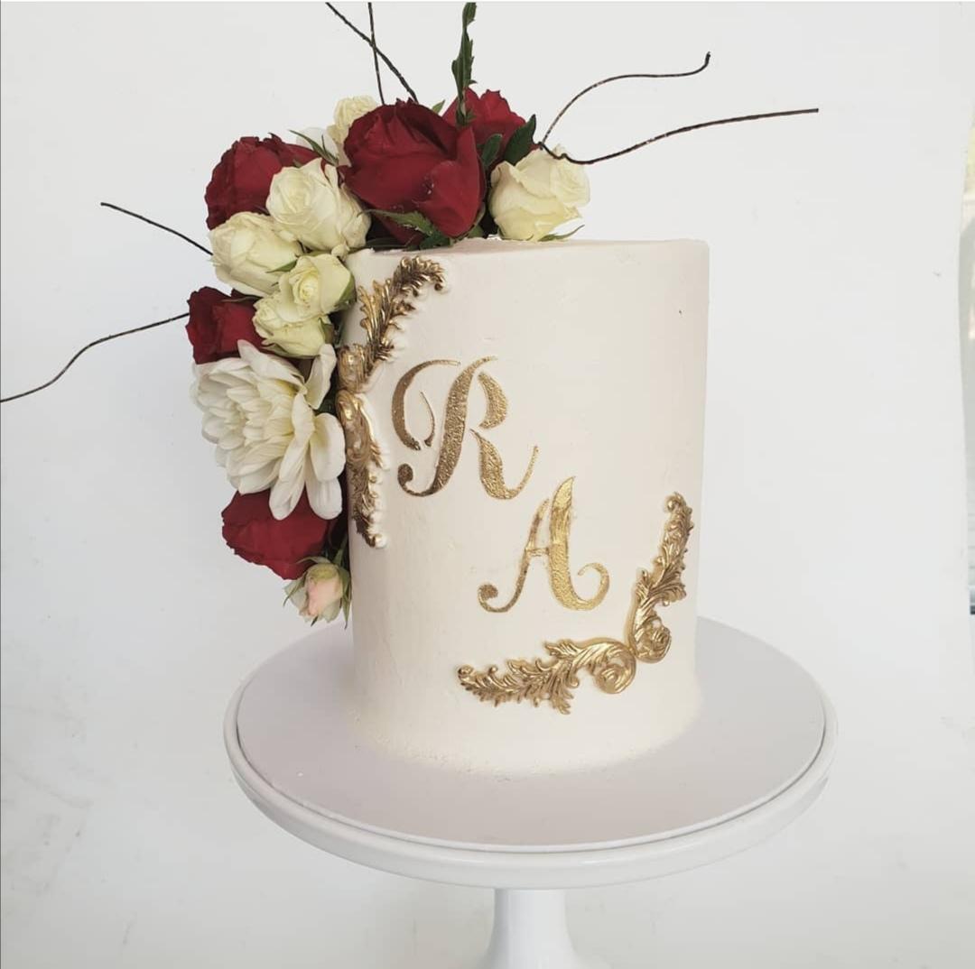Monogrammed single tier wedding cake